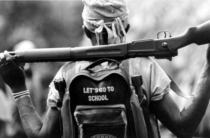 Name:  African Infantryman of the Year Liberian militias child soldiers AK 47 2.jpg Views: 2189 Size:  51.7 KB